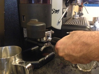 A slide of the grinder's lever drops in the right amount of coffee per serving.